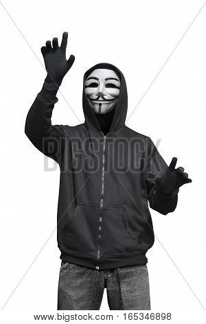 Man With Anonymous Mask Touching Something