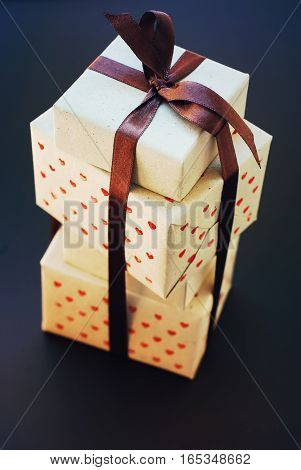 Stack Of Boxes With Gifts In Vintage Handmade Paper