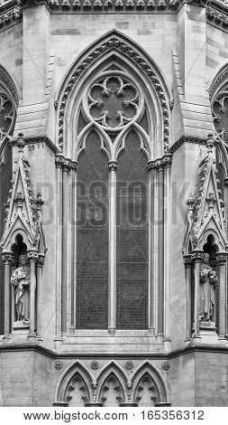 Cambridge Cambridgeshire United Kingdom - June 24 2006: Architectural exterior detail of St Johns College Chapel in Cambridge University. Designed by George Gilbert Scott in 1861. Black and white.