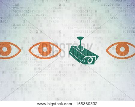 Protection concept: row of Painted orange eye icons around green cctv camera icon on Digital Data Paper background