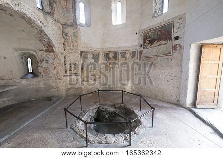 AGLIATE, ITALY - NOVEMBER 1, 2016: Agliate Brianza (Monza Lombardy Italy): interior of the medieval church of Saints Peter and Paul built from the 11th century Baptistery