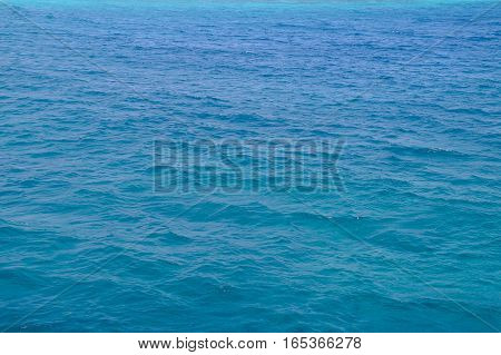 Red Sea background, clean blue water, small waves