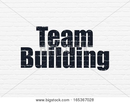 Finance concept: Painted black text Team Building on White Brick wall background