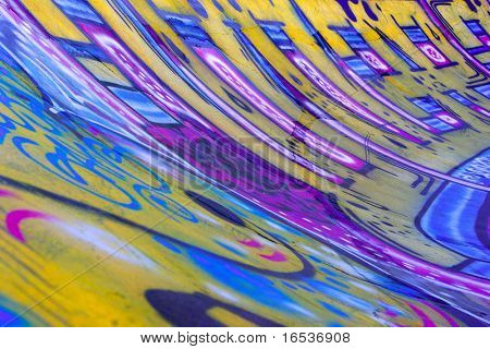 Grunge background with detail of colorful graffiti on a Skateboard track.