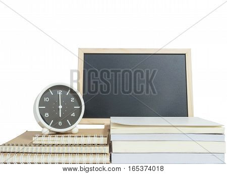 Closeup alarm clock for decorate show 6 o'clock on pile of book with wood black board isolated on white background