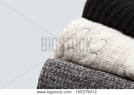 Warm knitted cloth details background with empty space