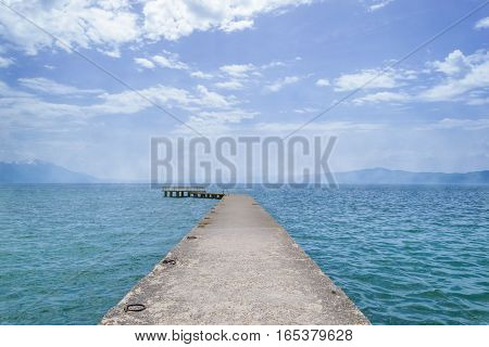 Boat dock in the deep blue lake.