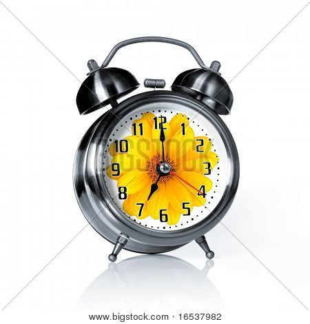 Spring time old fashion alarm clock with a printed flower