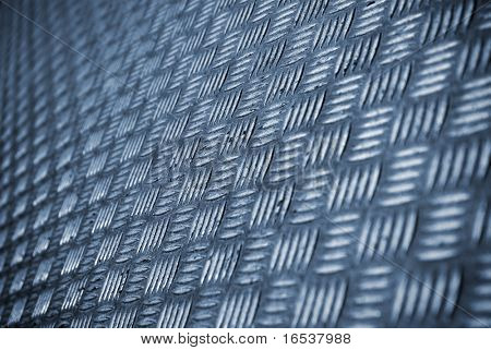 Background photo of a industrial metallic floor with bumpy pattern