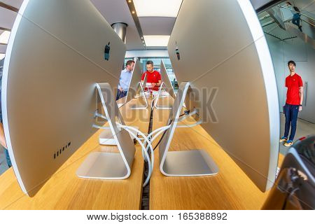 Hong Kong, China - December 4, 2016: close up imac personal computers inside Apple store, IFC Mall, Central District. Apple is world leader in consumer tablets, computers and mobiles. Fish-eye view.