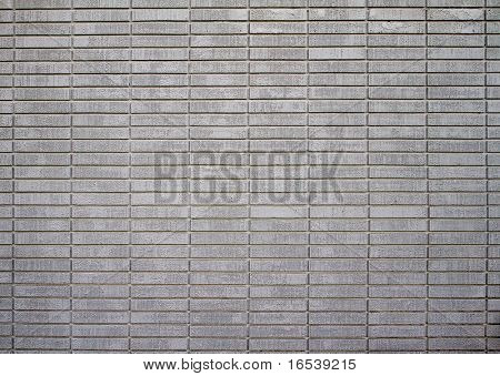 Large wall of white painted bricks taken from distance
