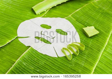 Sheet Mask With Aloe On A Background Of Banana Leaf. Organic Cosmetics Concept