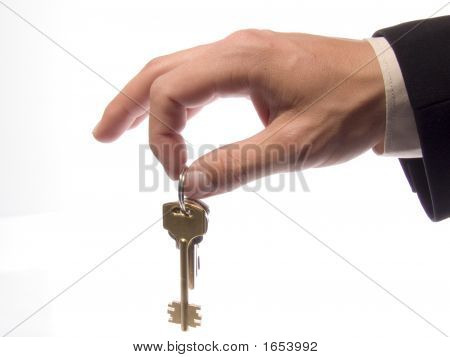 Hand With Keys On A White Background.