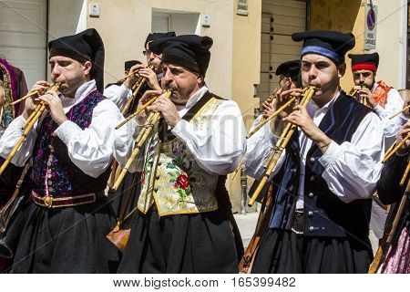 CAGLIARI, ITALY - May 1, 2016: 360 Feast of Saint Efisio - Sardinia - group of launeddas musicians parading in traditional Sardinian costume