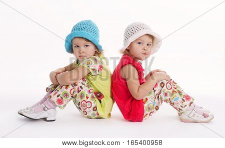 photo of two cute twins girls on white