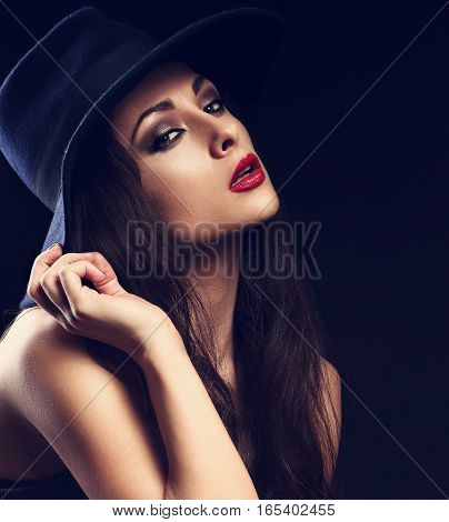 Beautiful Cool Female Model With Long Hair Posing In Blue Fashion Hat And Bright Red Lipstick On Dar