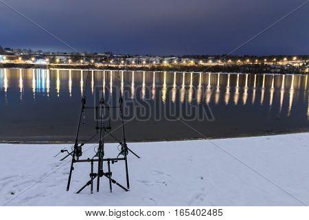 Carp Spinning Reel Angling Rods In Winter Night. Night Fishing
