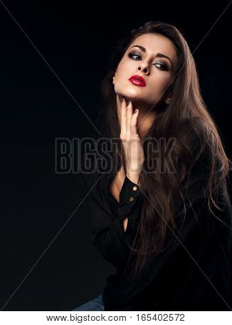 Sexy Thinking Female Model With Long Brown Hair Posing In Black Shirt On Dark Background With Red Li