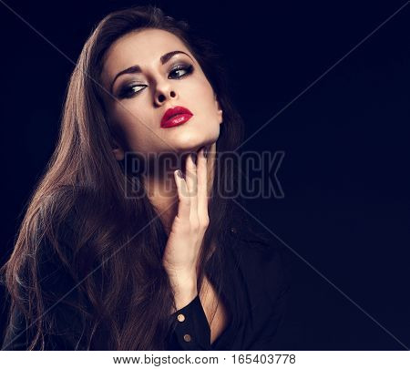 Thinking Melancholy Female Model With Long Brown Hair Posing In Black Shirt On Dark Background With