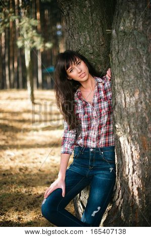 Attractive woman with country look outdoors shot american country style. summer