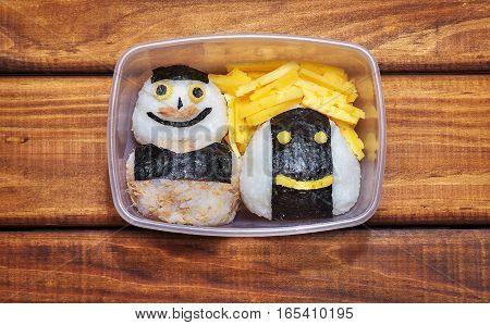 Onigiri in bento box. Funny faces on rice balls