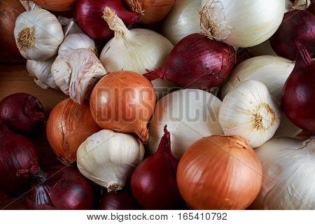 Garlic, onion mix in wooden box. background