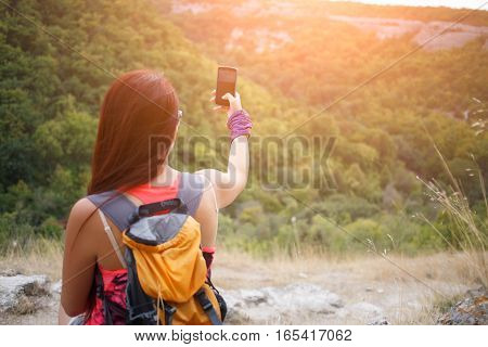 Woman sitting back pictures of mountain landscape