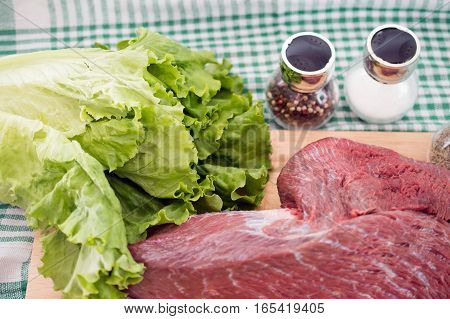 fresh meat, spices, solt and salad leaves
