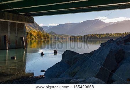The Kenai River flows under the Cooper Landing Bridge on the Kenai Peninsula in south central Alaska.