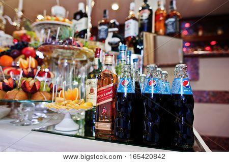 Hai, Ukraine - January 5, 2017: Different Bottles On Bar Reception With Red Label And Pepsi.