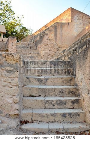 Old yellow stone staircase of limestone in the of Santa Barbara castle