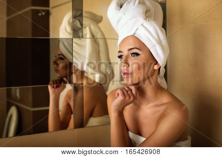 Woman With White Towel On Head.