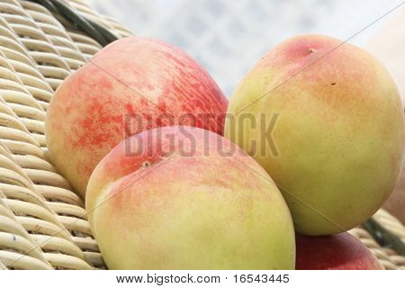 The fresh peach with white background .