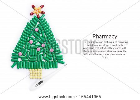 Tablets in the form of a Christmas tree and a thermometer underneath. Science pharmacy