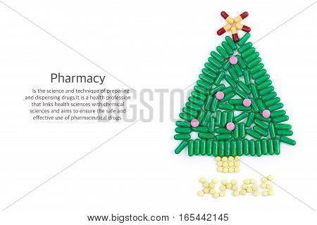 Tablets in the form of Christmas tree and the words under it. Science pharmacy