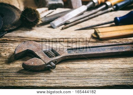Old Wrench On Wooden Background
