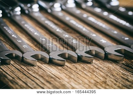 Set Of Wrenches On Wooden Background