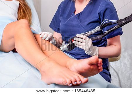 Close Up Laser Hair Removal In The Beauty Salon. Woman Having Legs Epilation. Selective Focus