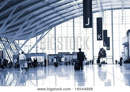 passenger at the airport, motion blur