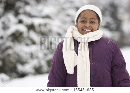 African American girl wearing a hat and scraf.