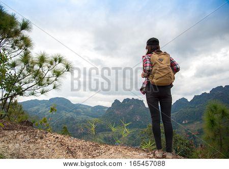 Traveler woman feeling victorious facing on the mountain Thailand