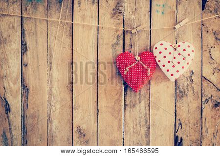 Two Heart Fabric Hanging On Clothesline And Wood Background With Space.