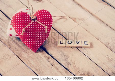Heart Fabric And Wood Text Of Love On Wooden Table Background.