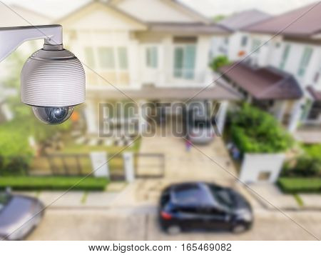Home security concept, CCTV camera or surveillance operating in village