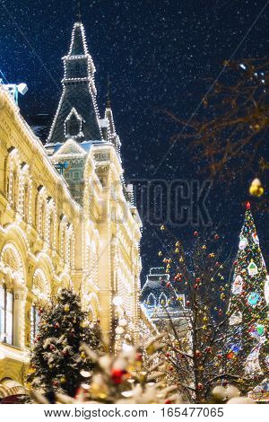 Christmas Fair with lights and falling snow. Christmas. New Year.Moscow. GUM