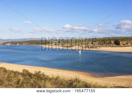 The river flows into the Atlantic Ocean in the west of Portugal. Vila Nova de Milfontes, Portugal.