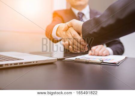 Business Man. Business handshake and business people. Business handshake. Business handshake and business people concept. Two business men shaking hands over sunny office background. business Partnership, Deal. business sunset.