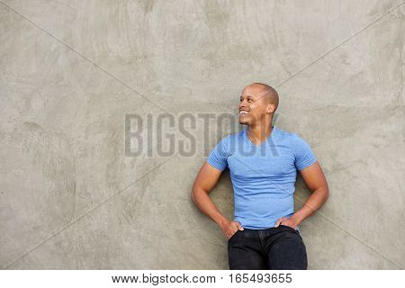 Handsome Black Man In T-shirt Smiling And Looking Away