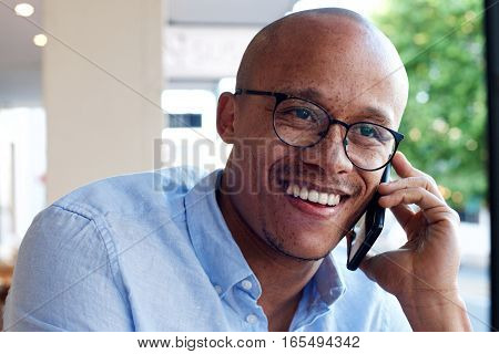 African American Businessman Smiling And Talking On Mobile Phone