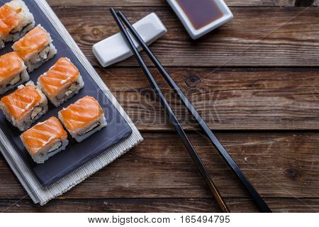 Delicious fresh rolls with salmon closeup, traditional Japanese theme